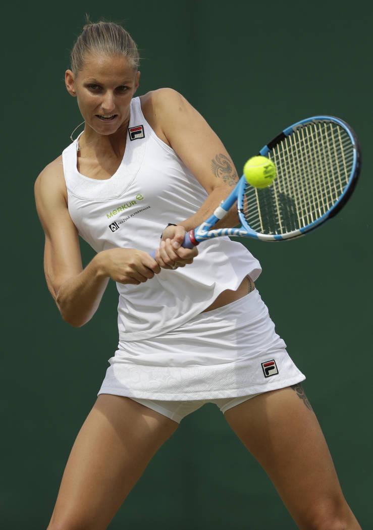 Karolina Pliskova of the Czech Republic returns the ball to Kiki Bertens of the Netherlands during their women's singles match on the seventh day at the Wimbledon Tennis Championships in London, M ...