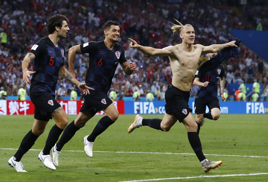 Croatia's Domagoj Vida, right, celebrates with his teammates after scoring his side's second goalduring the quarterfinal match between Russia and Croatia at the 2018 soccer World Cup in the Fisht ...