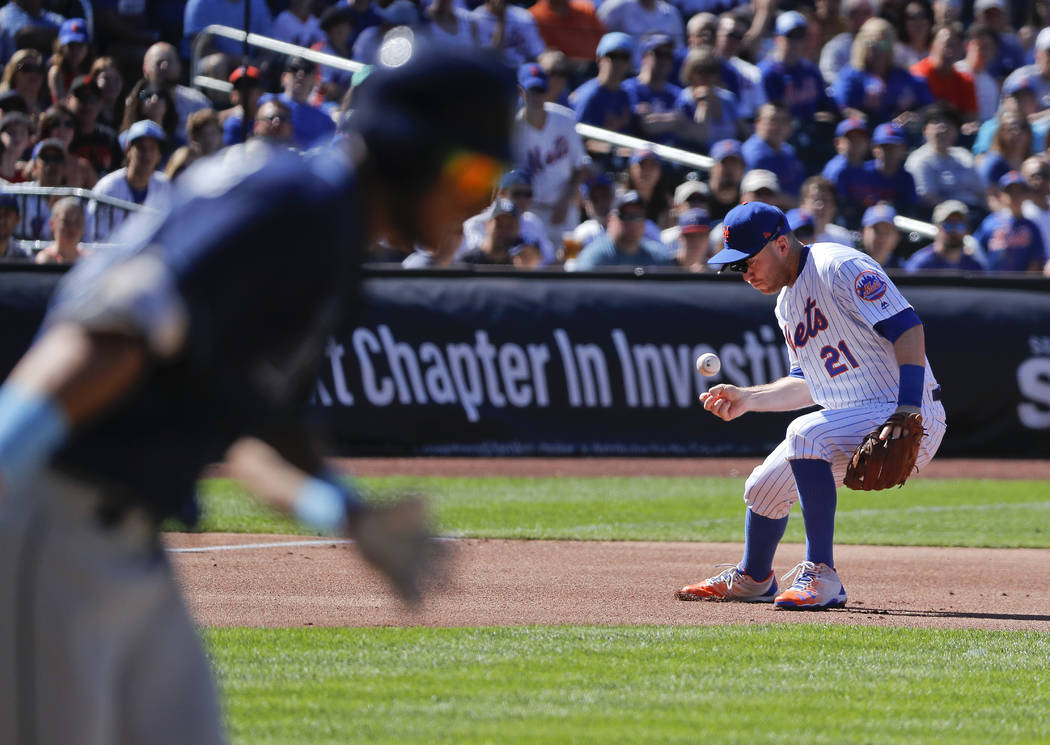 New York Mets third baseman Todd Frazier (21) cannot handle a ground ball hit by Tampa Bay Rays Kevin Kiermaier during the first inning of a baseball game, Saturday, July 7, 2018, in New York. Kie ...