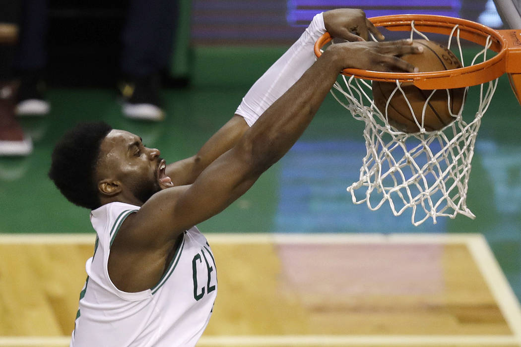 Boston Celtics guard Jaylen Brown dunks against the Cleveland Cavaliers during the second half in Game 7 of the NBA basketball Eastern Conference finals, Sunday, May 27, 2018, in Boston. (AP Photo ...