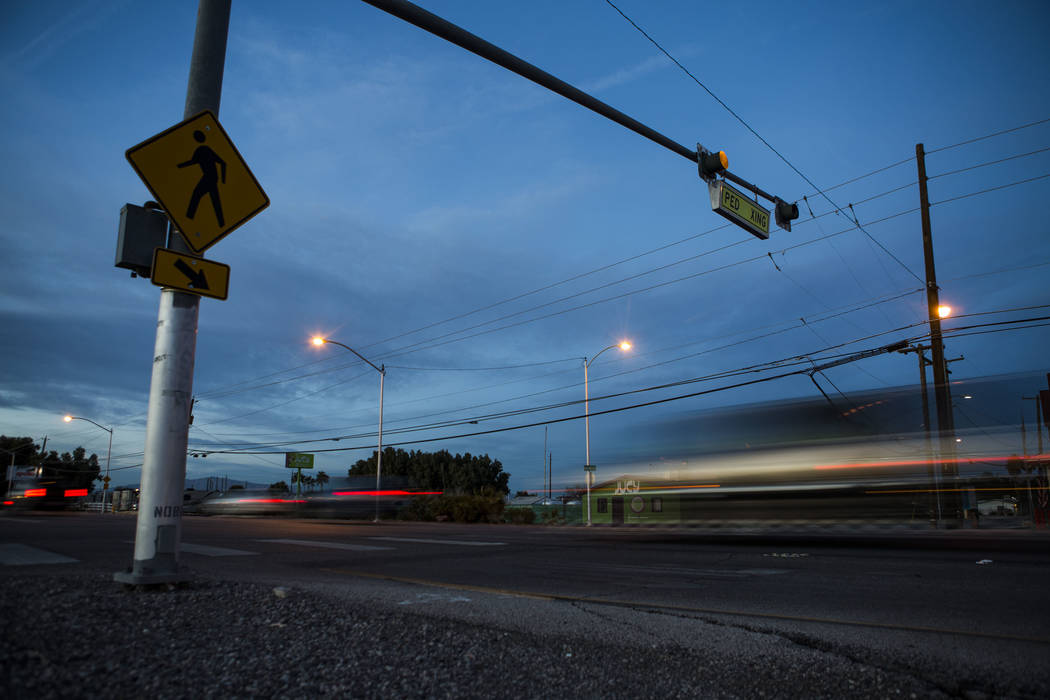 Cars drive by a crosswalk at the intersection of Whitney Avenue and Boulder Highway in Las Vegas. (Patrick Connolly/Las Vegas Review-Journal) @PConnPie