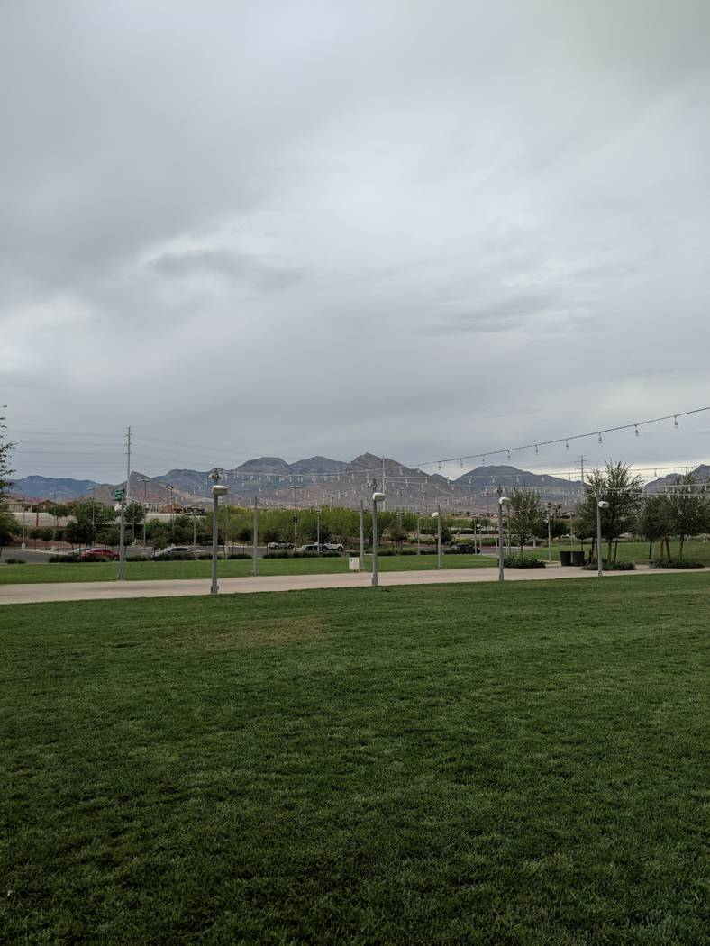 String lights hang over the lawn at Downtown Summerlin, on Thursday, July 12. The bistro-style lighting isn't allowed in Summerlin's residential areas, except for temporary uses like events. Some ...