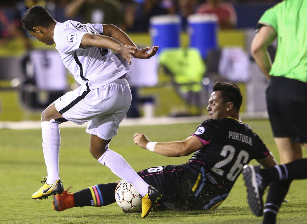 Las Vegas Lights FC midfielder Julian Portugal (26) moves in to block the ball controlled by San Antonio FC midfielder Pecka (8) during the first half of a United Soccer League game at Cashman Fie ...