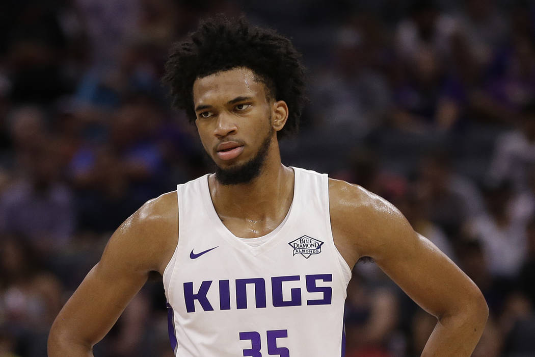 Sacramento Kings rookie forward Marvin Bagley III, walks down court after a timeout during the first half of an NBA summer league basketball game against the Miami Heat. Thursday, July 5, 2018, in ...