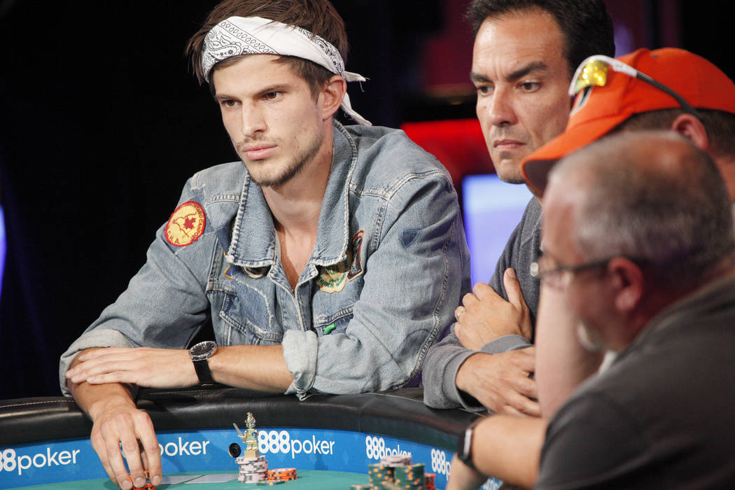 Mario Mosbock, from left, and Ahmid Amin compete during day five of the World Series of Poker tournament at the ESPN feature table at the Rio Convention Center in Las Vegas, Monday, July 9, 2018. ...