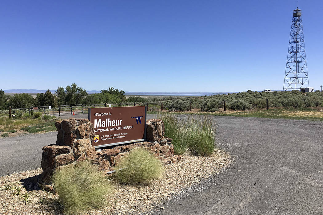 This photo taken June 21, 2016, shows a locked gate that blocks the road at the headquarters of the Malheur National Wildlife Refuge near Burns, Ore., more than four months after the last occupier ...