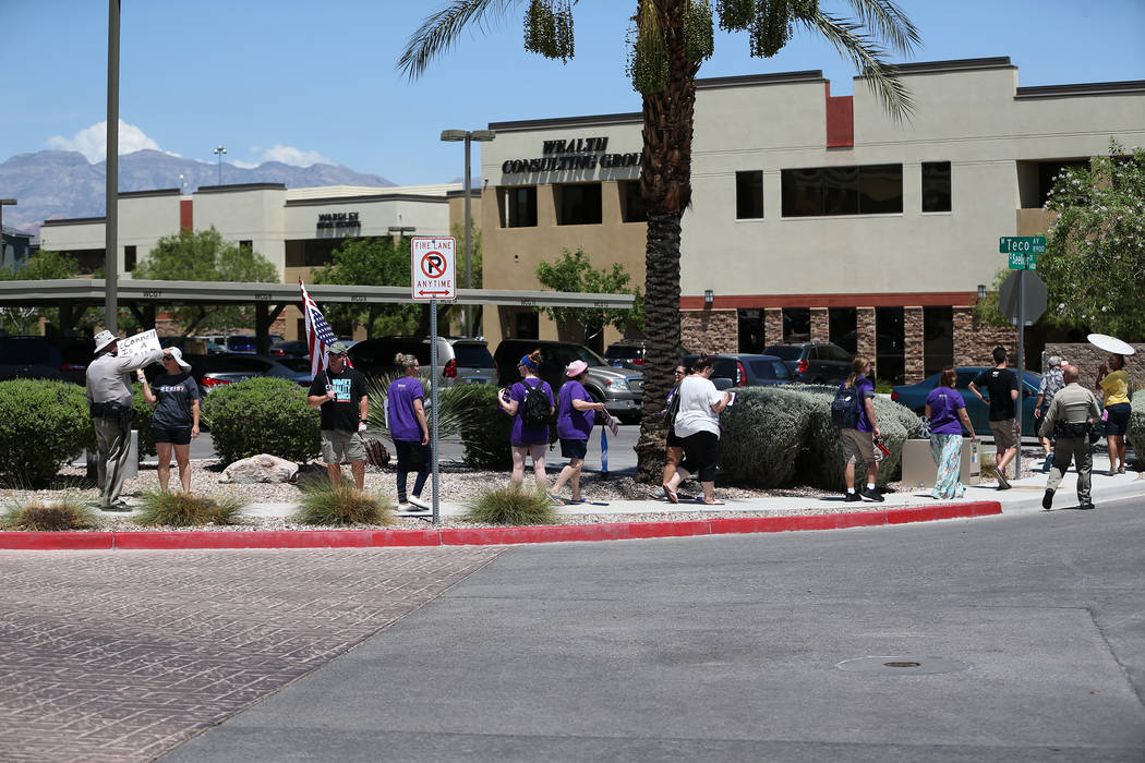 People attend a rally hosted by the Nevada Democrats and NARAL to protest the Supreme Court pick outside of the office building of U.S. Sen. Dean Heller, R-Nev., in Las Vegas, Tuesday, July 10, 20 ...