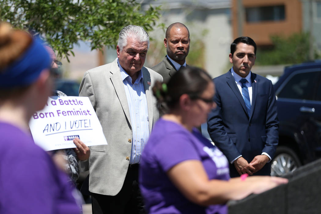 Clark County Commissioner Steve Sisolak, left, Senate Majority Leader Aaron Ford and Assemblyman Nelson Araujo attend a rally hosted by the Nevada Democrats and NARAL to protest the Supreme Court ...