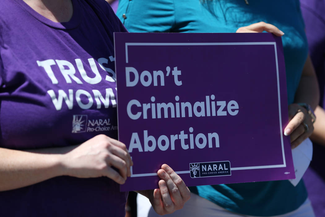 A sign during a rally hosted by the Nevada Democrats and NARAL to protest the Supreme Court pick outside of the office building of U.S. Sen. Dean Heller, R-Nev., in Las Vegas, Tuesday, July 10, 20 ...