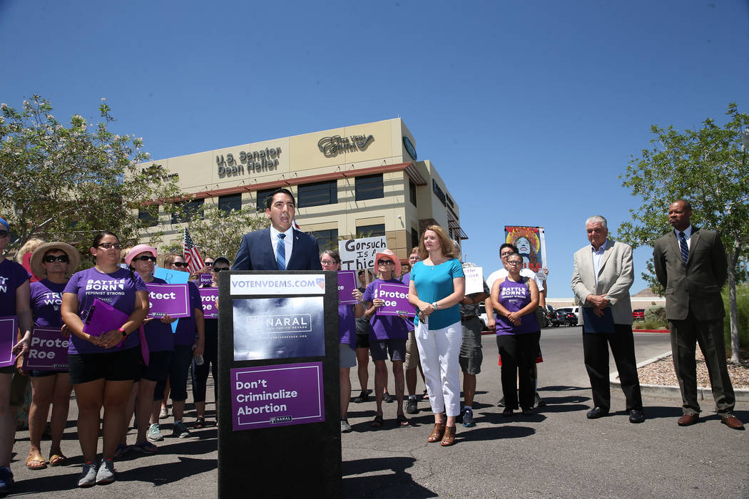 Assemblyman Nelson Araujo speaks during a rally hosted by the Nevada Democrats and NARAL to protest the Supreme Court pick outside of the office building of U.S. Sen. Dean Heller, R-Nev., in Las V ...