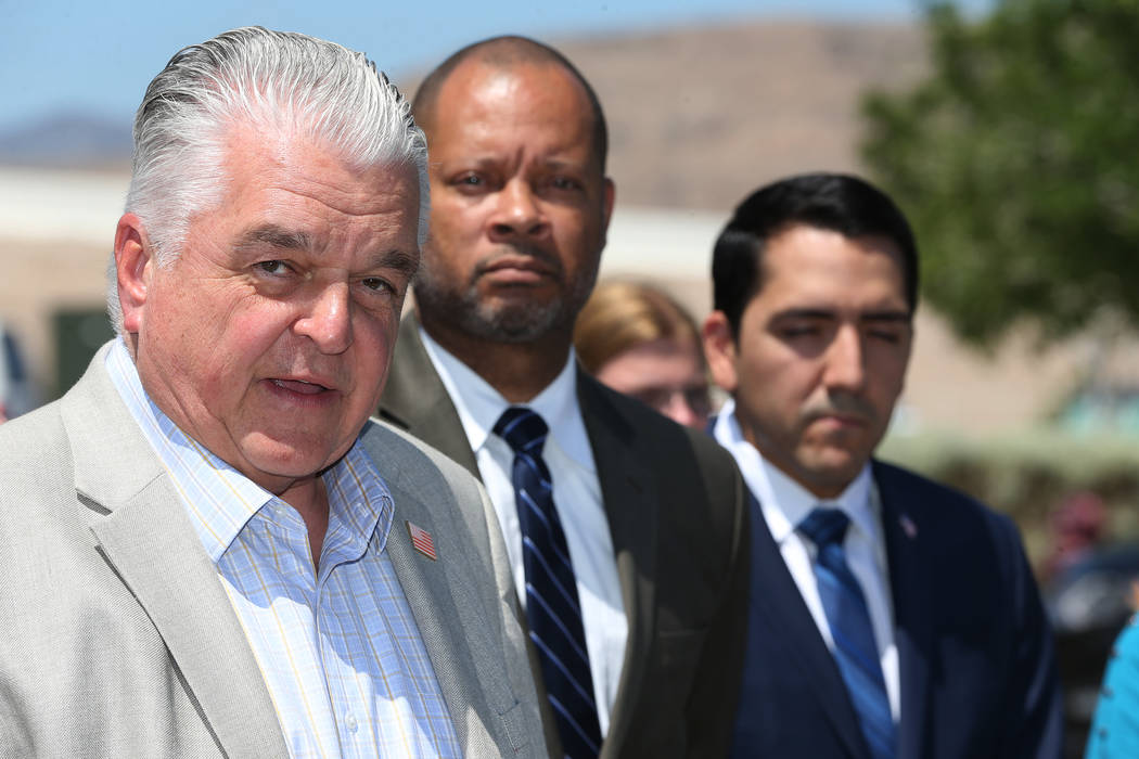 Clark County Commissioner Steve Sisolak, left, Senate Majority Leader Aaron Ford and Assemblyman Nelson Araujo speak during a rally hosted by the Nevada Democrats and NARAL to protest the Supreme ...