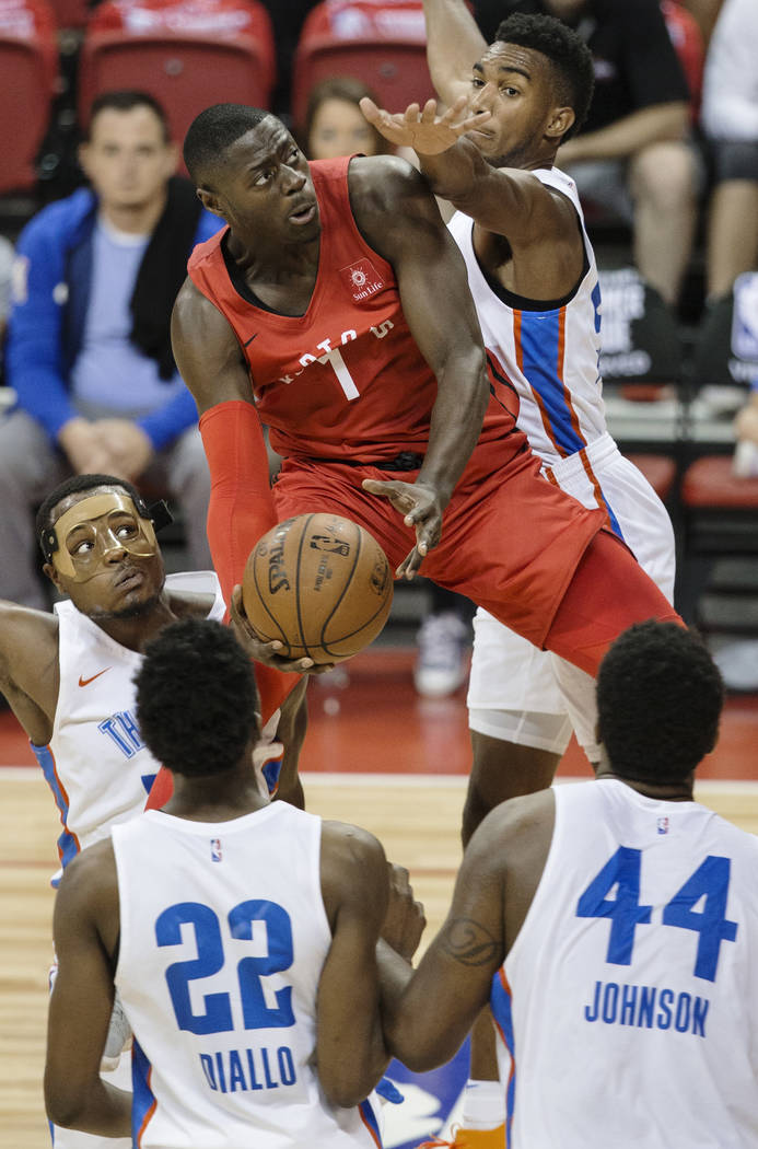 Toronto Raptors guard Rawle Alkins (1) drives past Oklahoma City Thunder defenders Hamidou Diallo (22) and Dakari Johnson (44) in the fourth quarter during the NBA Summer League on Monday, July 9, ...