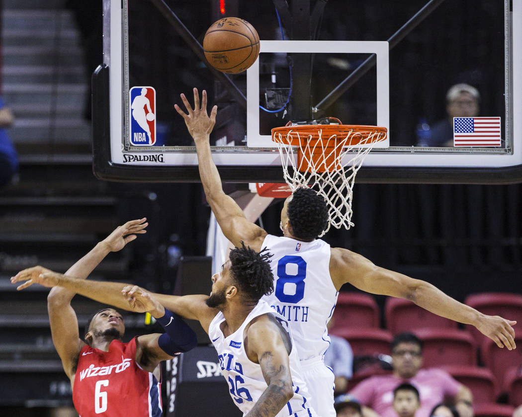 Philadelphia 76ers guard Zhaire Smith (8) blocks the shot of Washington Wizards guard Troy Brown, Jr. (6) in the first quarter during the NBA Summer League on Monday, July 9, 2018, at the Th ...