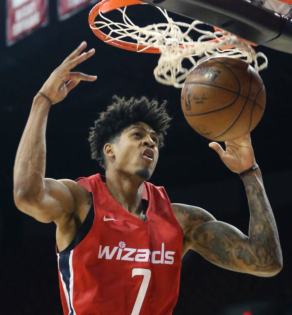 Washington Wizards' forward Devin Robinson (7) dunks against the San Antonio Spurs during an NBA Summer League basketball game at the Thomas and Mack Center on Sunday, July 8, 2018, in Las Vegas. ...