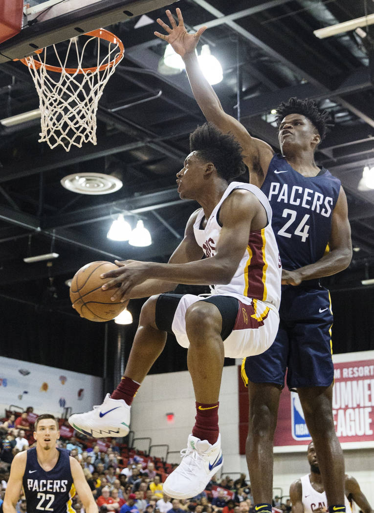 Cleveland Cavaliers guard Collin Sexton (2) drives past Indiana Pacers forward Alize Johnson (24) in the first quarter during the NBA Summer League on Monday, July 9, 2018, at Cox Pavilion, in Las ...