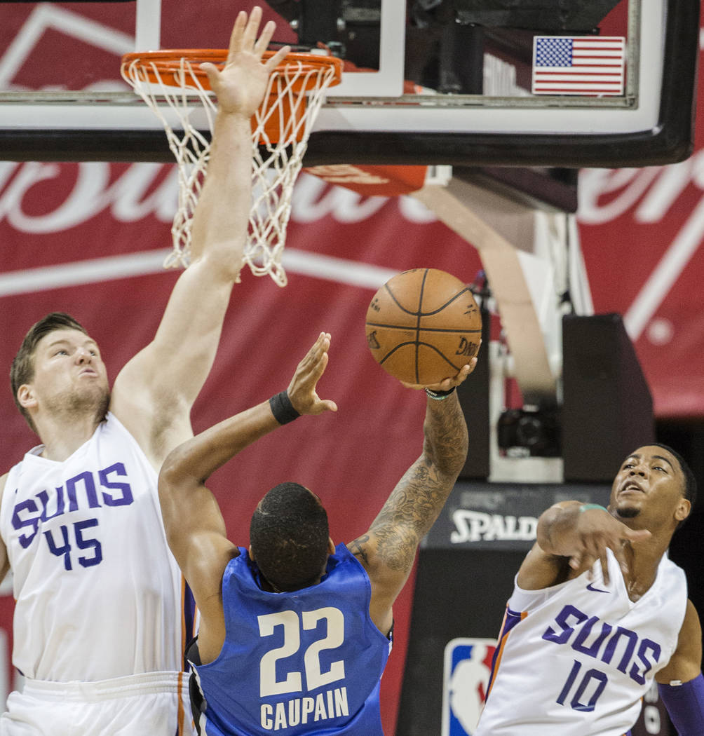 Phoenix Suns center Jack Cooley (45) and guard Shaquille Harrison (10) leap to block the shot of Orlando Magic guard Troy Caupain (22) in the first quarter during the NBA Summer League on Monday, ...