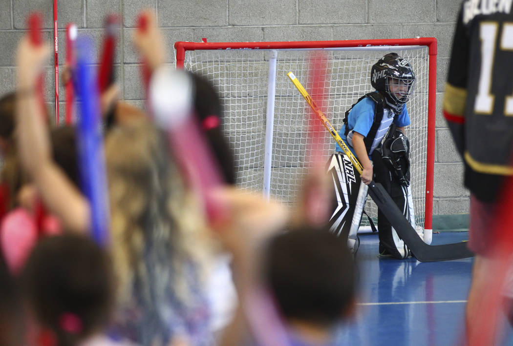 Six-year-old AJ defends the goal during a street hockey clinic held by the Vegas Golden Knights for local Las Vegas youth at Paradise Recreation Center, 4775 S. McLeod Drive, on Thursday, June 22, ...
