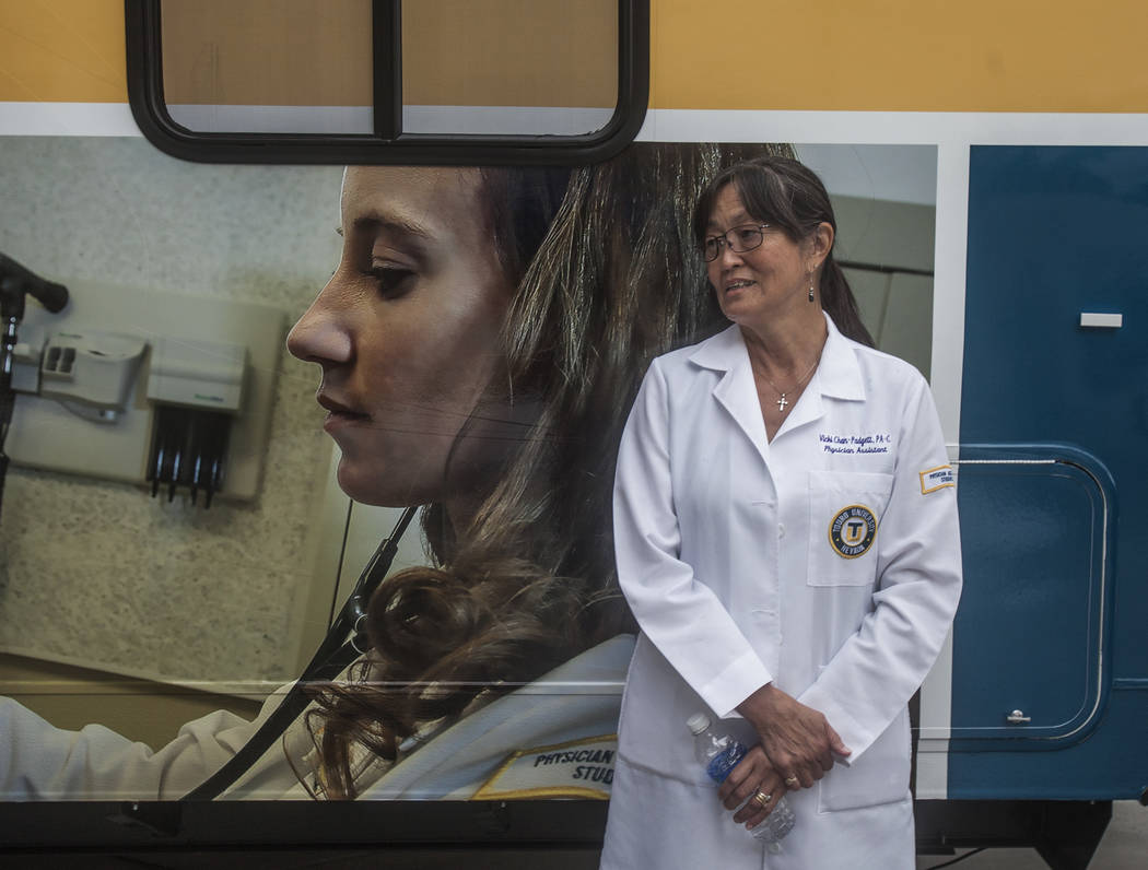 Vicki Chan-Padgett stands in front of a mobile healthcare clinic in this file photo. (Jeff Scheid/Las Vegas Review-Journal)