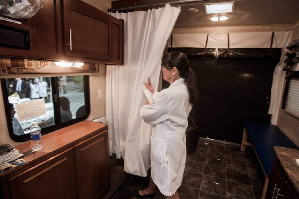Vicki Chan-Padgett opens a curtain in the mobile healthcare clinic in this file photo. (Jeff Scheid/Las Vegas Review-Journal)