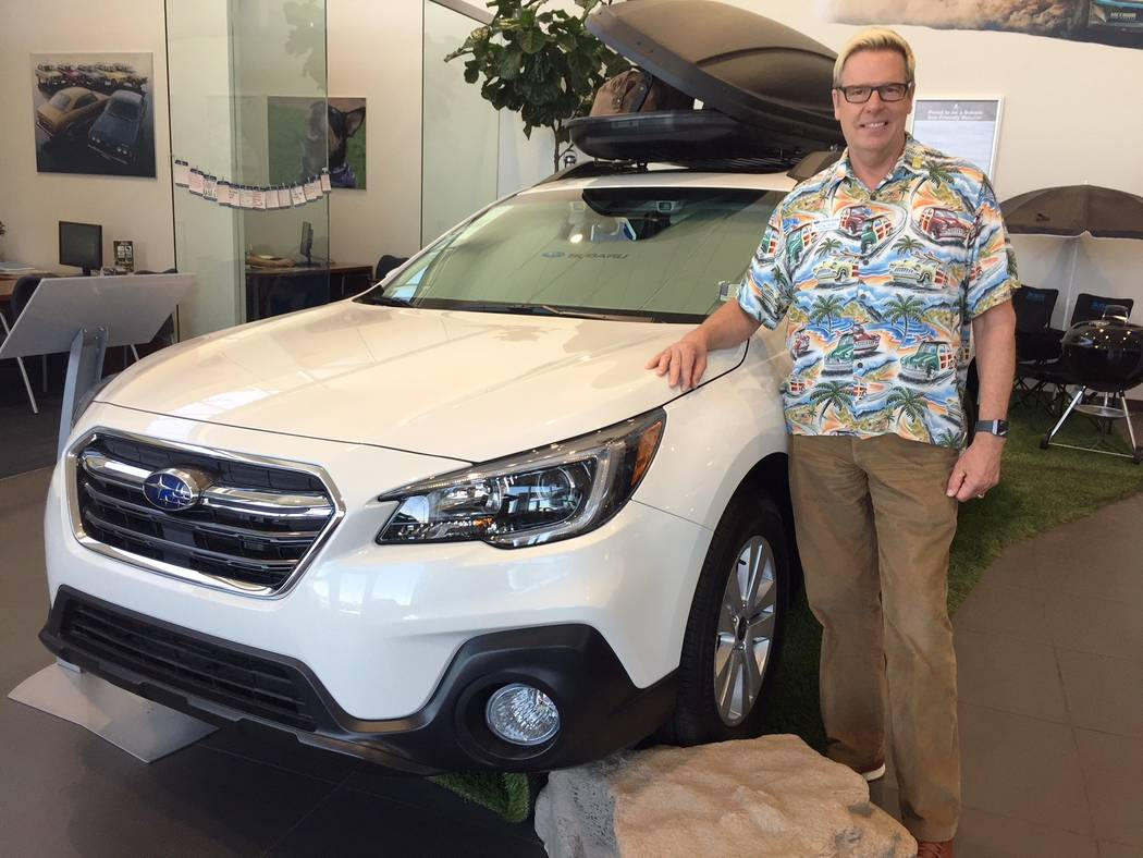 Subaru of Las Vegas general manager Burton Hughes is seen with a 2018 Outback at the dealership at 6455 Roy Horn Way.