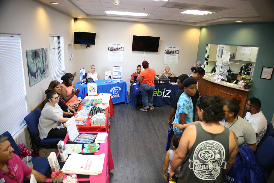 People attend a free back to school immunization and health clinic event hosted at the FirstMed Health and Wellness Center in Las Vegas, Saturday, July 14, 2018. Erik Verduzco Las Vegas Review-Jou ...