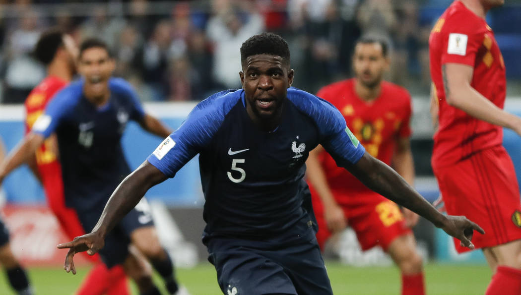 France's Samuel Umtiti celebrates after scoring his sides 1st goal of the game during the semifinal match between France and Belgium at the 2018 soccer World Cup in the St. Petersburg Stadium in, ...