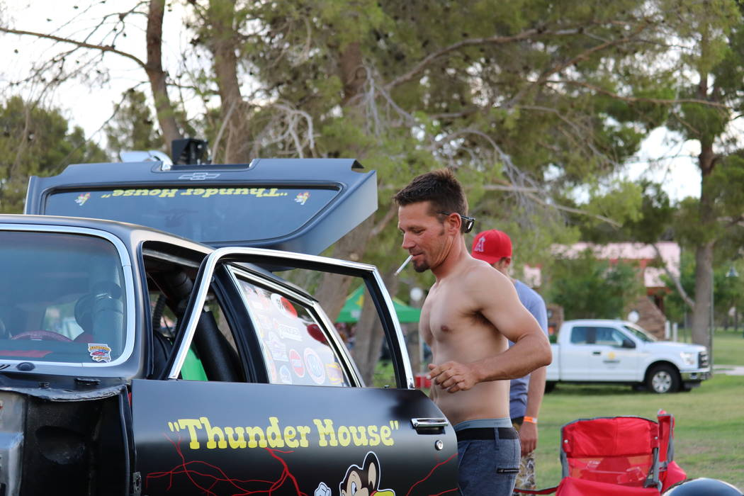 """Kyle Grayson of Las Vegas opens the door to his 1971 Chevrolet Vega gasser wagon, nicknamed """"Thunder Mouse"""" at the Slides, Rides & Rock and Roll event at Craig Ranch Regional Park in ..."""