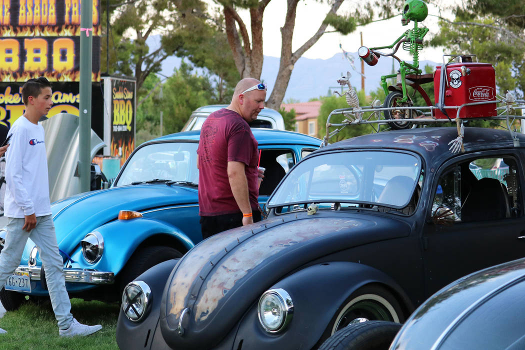 Onlookers check out classic Volkswagen Beetles at the inaugural Slides, Rides & Rock and Roll event at Craig Ranch Regional Park in North Las Vegas, Saturday, July 14, 2018. Hundreds of famili ...