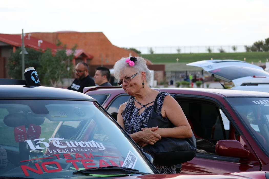 Lynn Bicknell of North Las Vegas examines a Mini Cooper at the inaugural Slides, Rides & Rock and Roll event at Craig Ranch Regional Park in North Las Vegas, Saturday, July 14, 2018. Hundreds ...