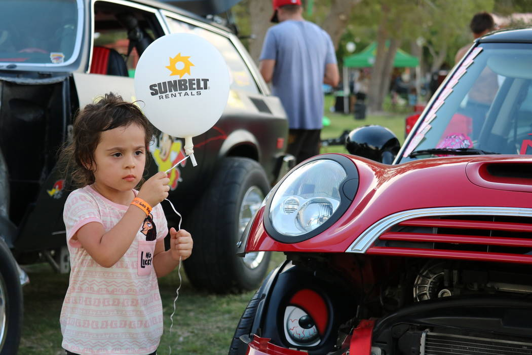 Chichi Hernandez, 4, of Las Vegas holds on tightly to her balloon after it almost floated away at the inaugural Slides, Rides & Rock and Roll event at Craig Ranch Regional Park in North Las Vegas, ...