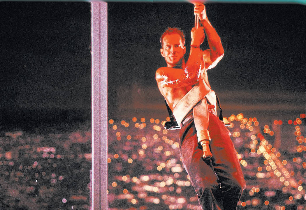 "This publicity photo released by Twentieth Century Fox Home Entertainment shows Bruce Willis in a scene from the 1988 film, ""Die Hard."" The ""Die Hard"" 25th Anniversary Collecti ..."