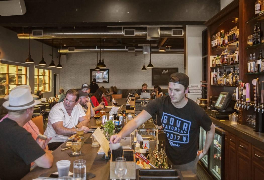 Guests enjoy dinner at Atomic Kitchen on Wednesday, July 11, 2018, in Las Vegas. Benjamin Hager Las Vegas Review-Journal @benjaminhphoto