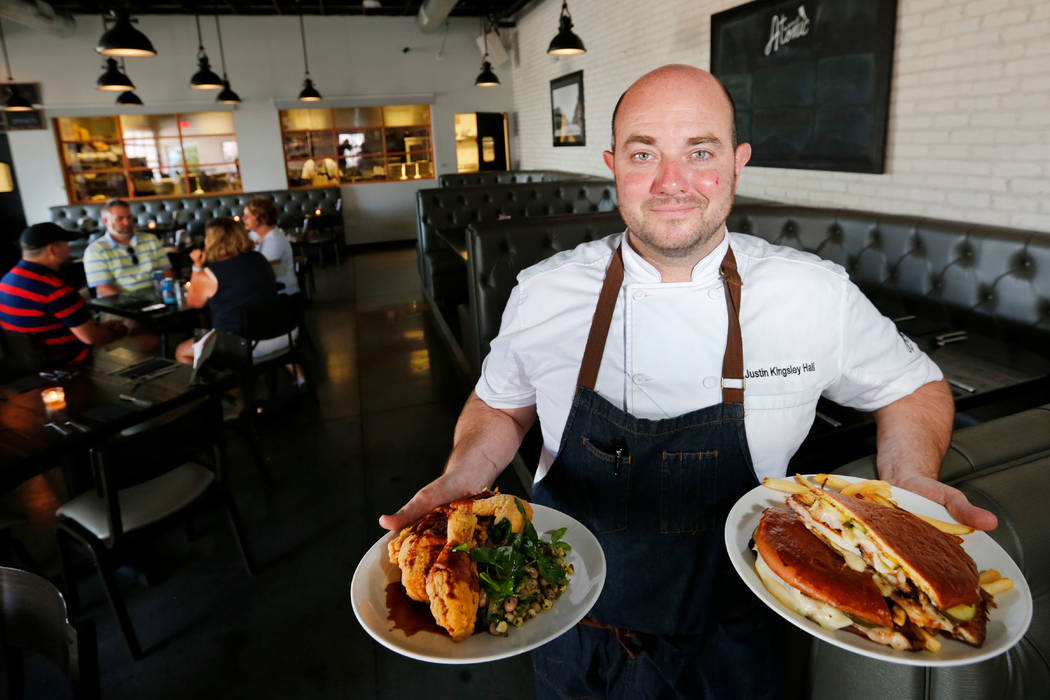 The Kitchen at Atomic Chef Justin Kingsley Hall shows Half-Chicken & Succotash, left, and Cigar City sandwich, right, at his restaurant in Las Vegas, Wednesday, July 11, 2018. Chitose Suzuki L ...