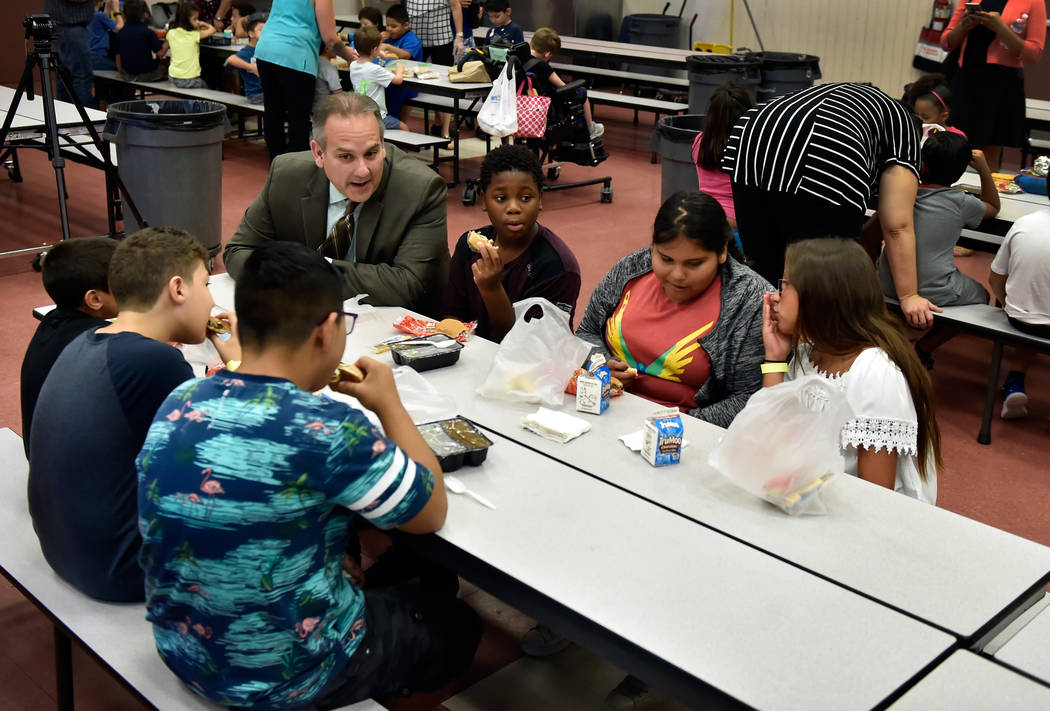 Clark County school's superintendent Jesus Jara speaks with students during lunch at Red Rock Elementary School Tuesday, July 10, 2018, in Las Vegas. The newly hired school boss stopped by to high ...