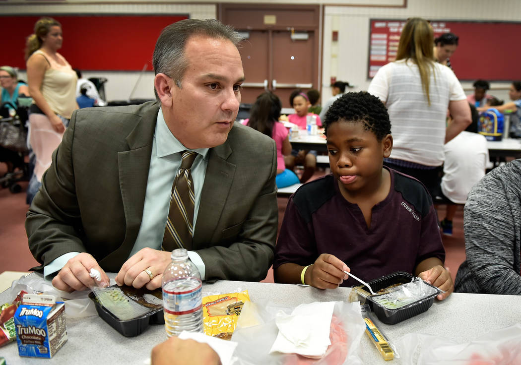 Clark County school's superintendentJesus Jara, left, speaks with students, including fifth-grader Tylian Basher during lunch at Red Rock Elementary School Tuesday, July 10, 2018, in Las Vegas. Th ...