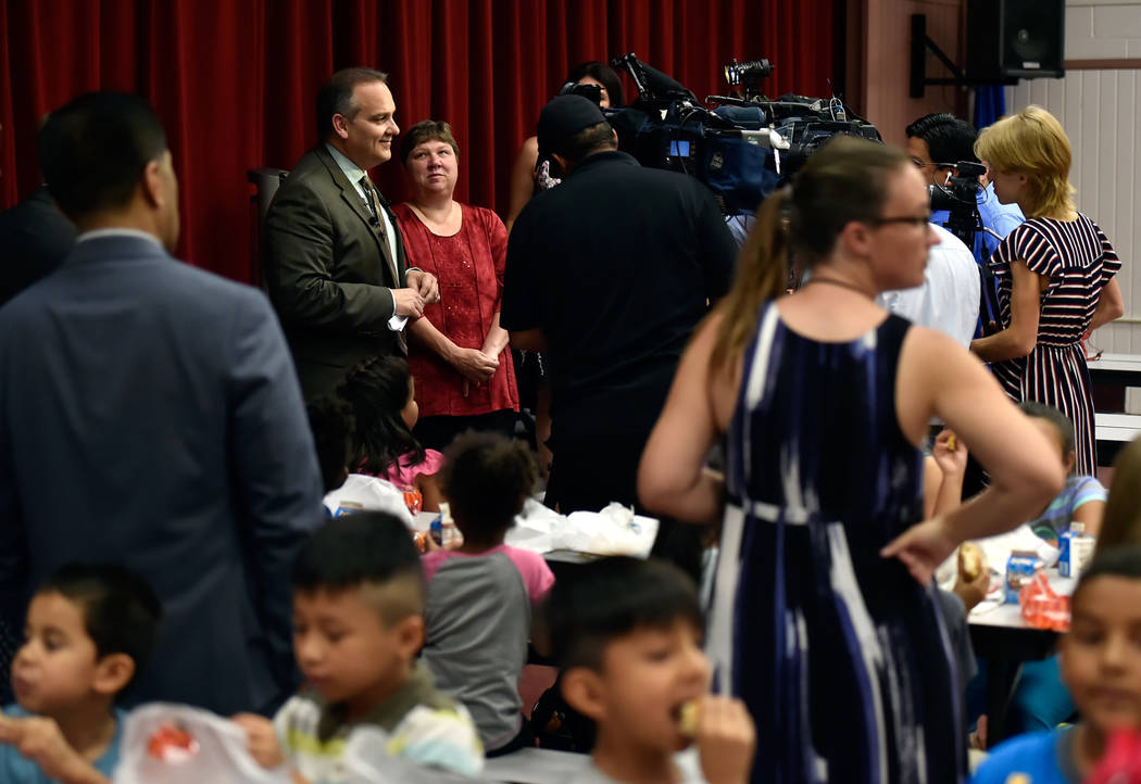 Clark County school's superintendent Jesus Jara, left, speaks with reporters as CCSD trustee president Deanna Wright looks on after he dined with students at Red Rock Elementary School Tuesday, Ju ...