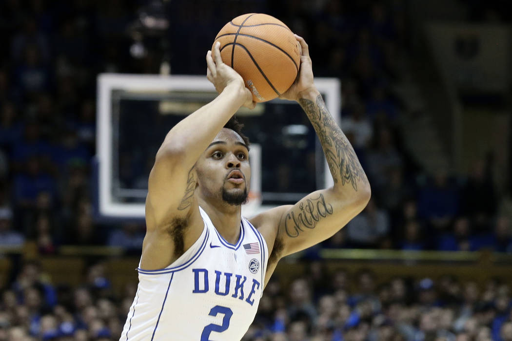In this Feb. 14, 2018, file photo, Duke's Gary Trent Jr. (2) shoots against Virginia Tech during the first half of an NCAA college basketball game in Durham, N.C. Trent is a possible pick in Thurs ...