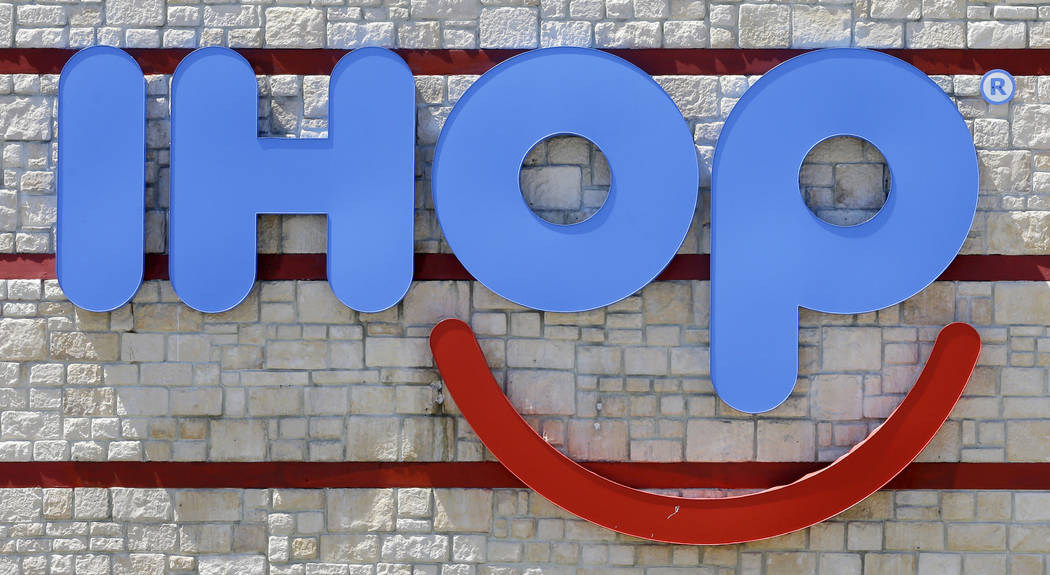 FILE - This May 11, 2017, file photo shows an IHOP sign at a restaurant in Hialeah, Fla. On Monday, July 9, 2018, it was back on social media, this time to promote a pancake deal tied to IHOP&#x20 ...