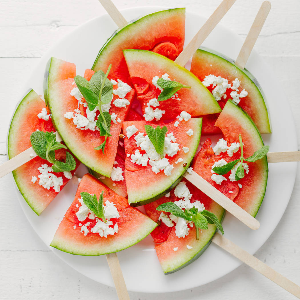Watermelon on sticks topped with feta cheese and mint. Getty Images