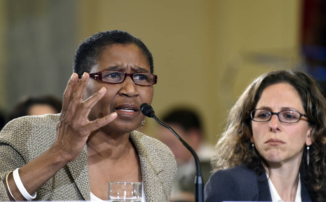 National Basketball Players Association Executive Director Michele Roberts, left, sitting next to National Hockey League Vice President and Deputy General Counsel Jessica Berman, testifies on Capi ...