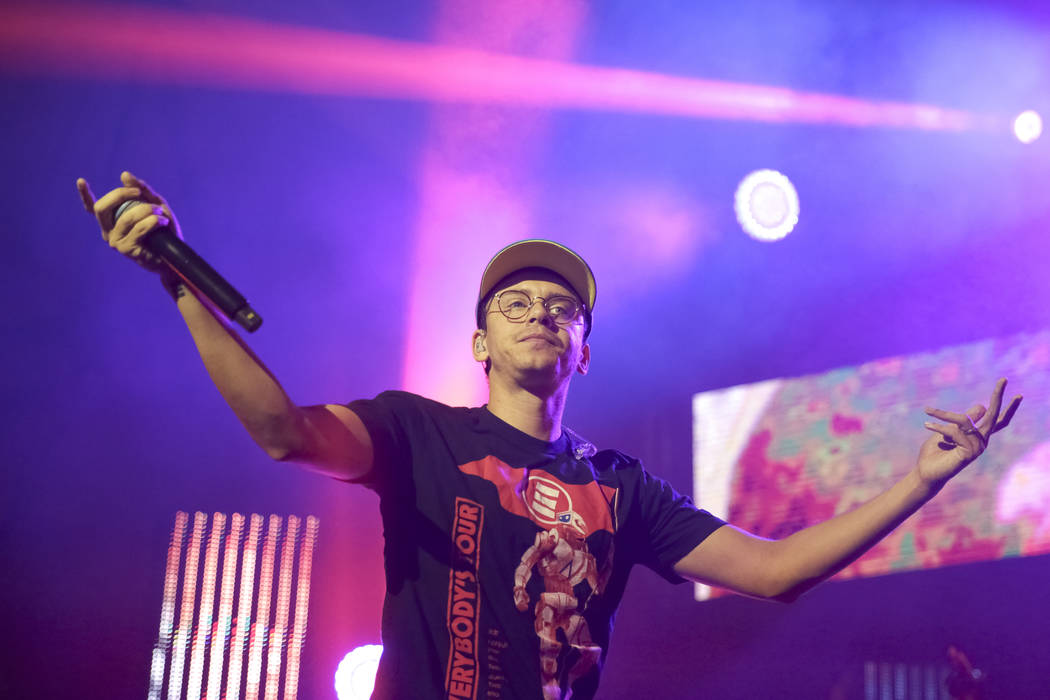 Rapper Logic performs on stage at the Pier Six Concert Pavilion on Thursday, Aug. 10, 2017, in Baltimore. (Photo by Brent N. Clarke/Invision/AP)
