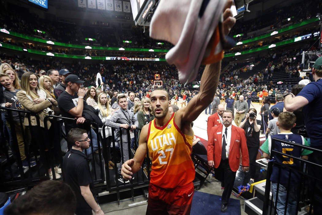 In this March 17, 2018, file photo, Utah Jazz center Rudy Gobert (27) celebrates as he leaves the court following their NBA basketball game against the Sacramento Kings, in Salt Lake City. (AP Pho ...