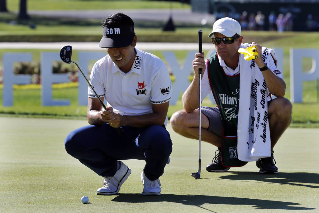 Kevin Na lines up a putt on the 18th hole with his caddie during the Military Tribute PGA Tour Golf Tournament at the Greenbrier in White Sulphur Springs, W. Va., Sunday, July 8, 2018. Na finished ...