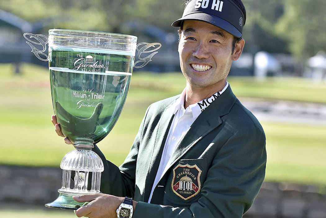Kevin Na poses with the trophy after winning the Military Tribute PGA Tour Golf Tournament at the Greenbrier Sunday, July 8, 2018, in White Sulphur Springs, W. Va. (Brad Davis/The Register-Herald ...
