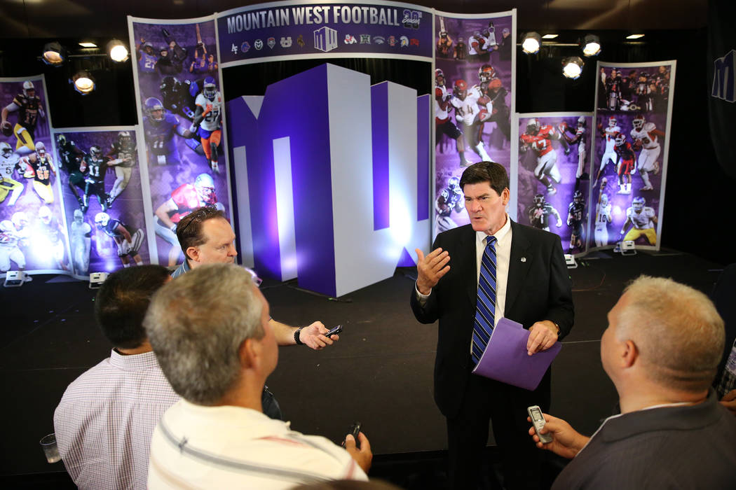 Commissioner Craig Thompson, center, is interviewed during the Mountain West Conference football media day at the Cosmopolitan hotel-casino in Las Vegas, Tuesday, July 24, 2018. Erik Verduzco Las ...