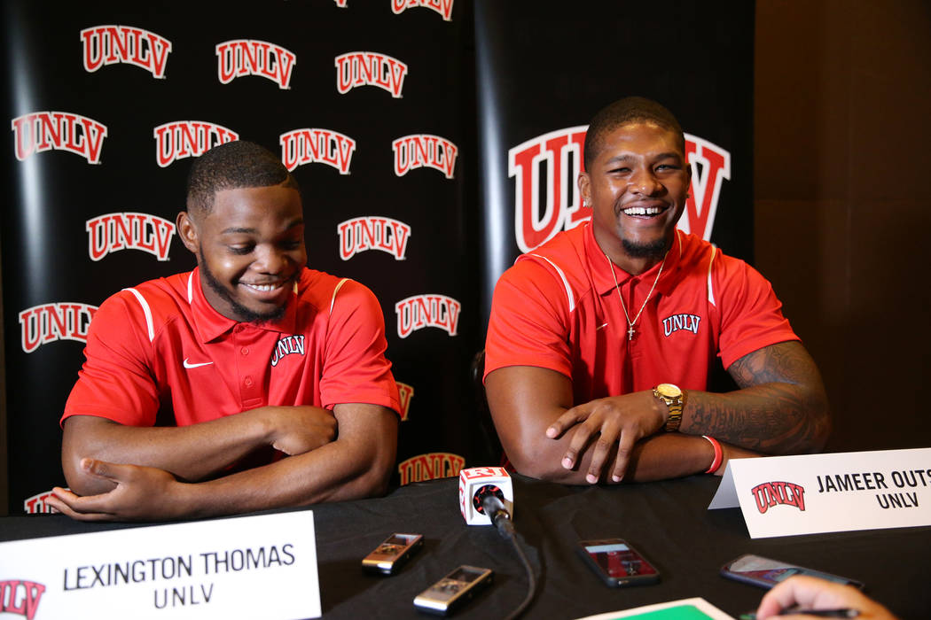 UNLV's Lexington Thomas, left, and Jammer Outsey are interviewed during the Mountain West Conference football media day at the Cosmopolitan hotel-casino in Las Vegas, Wednesday, July 25, 2018. Eri ...