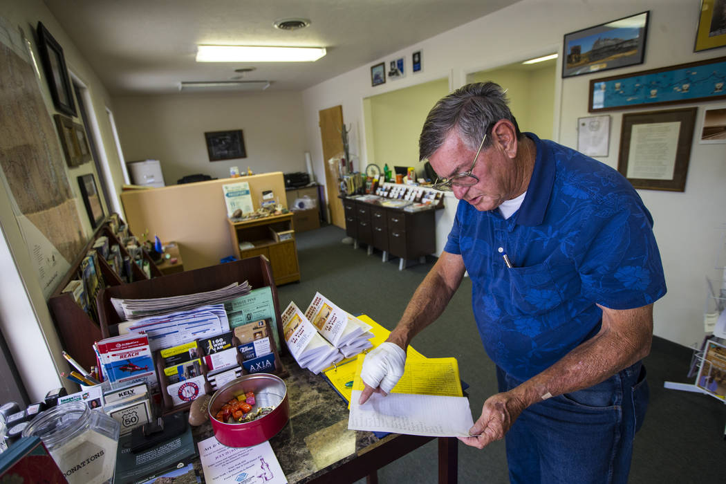 Wayne Cameron, executive director of the White Pine Chamber of Commerce, talks looks at visitors logs while talking about tourism in Ely on Tuesday, July 10, 2018. Chase Stevens Las Vegas Review-J ...