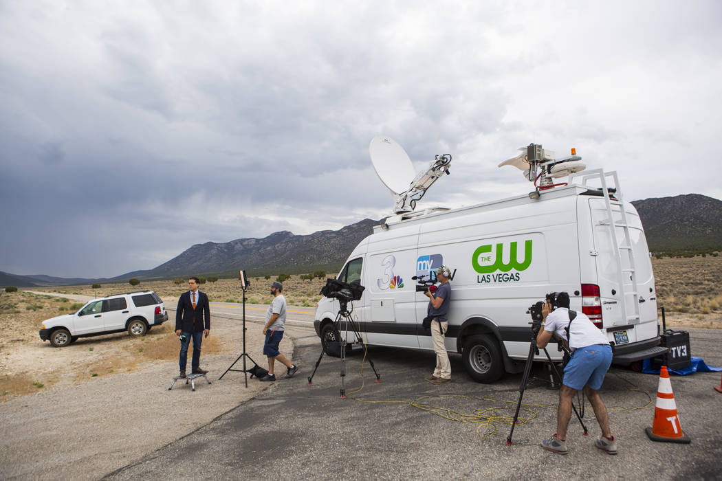 Members of the media, including KSNV Channel 3 reporter Nathan O'Neal, far left, gather outside of Ely State Prison ahead of the execution of Scott Dozier, slated for Wednesday, in Ely on Tuesday, ...