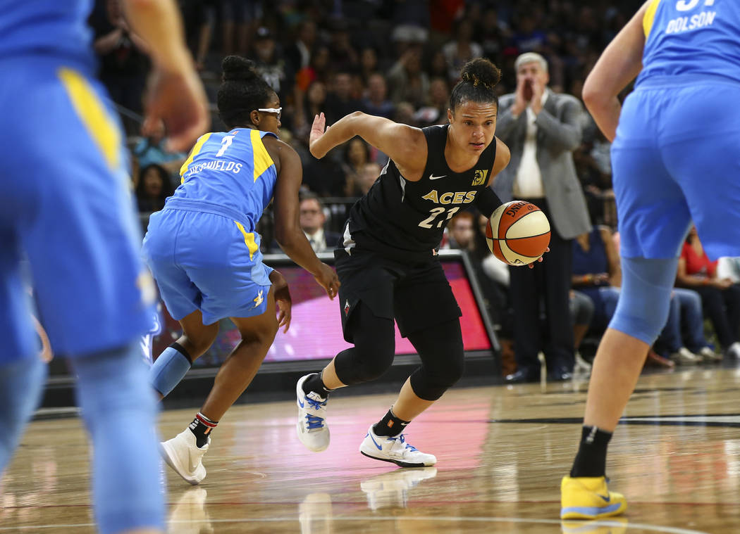 Las Vegas Aces guard Kayla McBride (21) drives past Chicago Sky guard Diamond DeShields (1) during the second half of a WNBA basketball game at Mandalay Bay Events Center in Las Vegas on July 5. ( ...