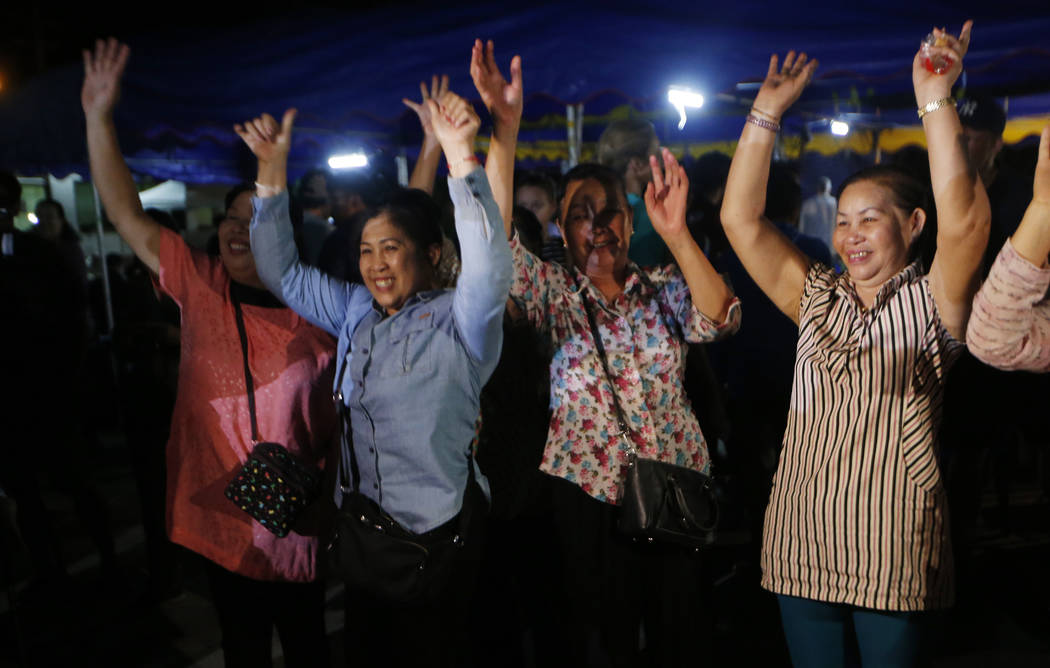 Peoples celebrate after evacuation in Chiang Rai as divers evacuated some of the 12 boys and their coach trapped at Tham Luang cave in the Mae Sai district of Chiang Rai province, northern Thailan ...